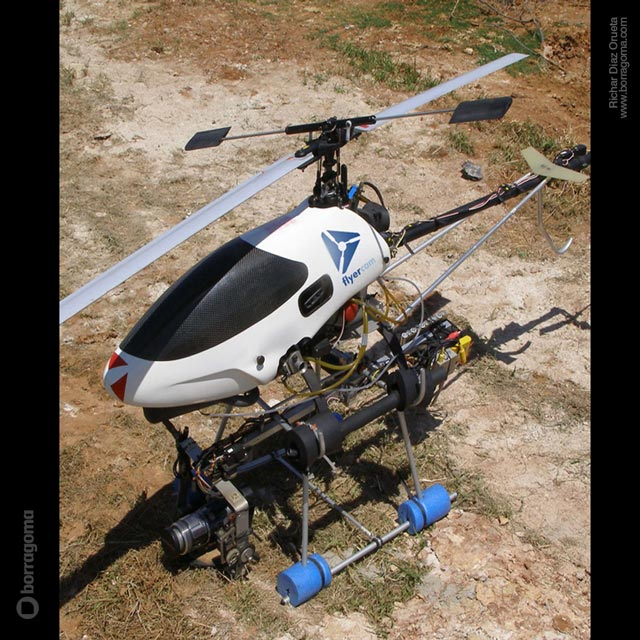 DIS FlyerCAM foto helicoptero 04 FlyerCam / Imagen Corporativa Trabajos Realizados Logotipo Imagen Corporativa Filmación Aérea Diseño Gráfico